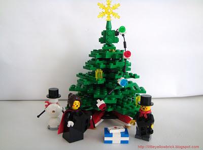https://nerdymindsmagazine.files.wordpress.com/2013/12/a7945-wintervillagetoyshop-christmastreesnowmanandcarollerswatermark.jpg