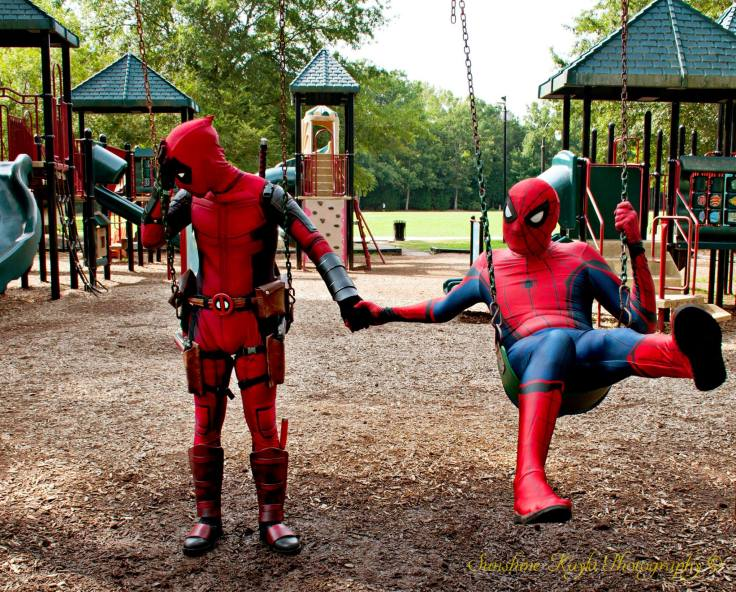 Spider-Man x Deadpool holding hands on swings, facepalm